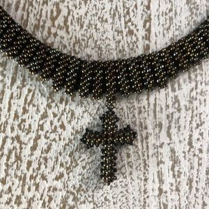 """Beaded 17"""" black and gold cross necklace"""